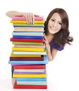 girl with stack color book . - stock photo