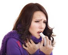 woman using throat spray. - stock photo