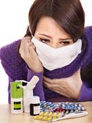 girl having flu taking pills - stock photo