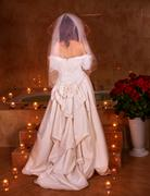 woman in  wedding dress relaxing in sauna. - stock photo