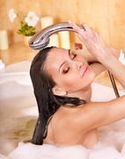 Stock Photo of woman take bubble  bath.