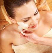 Stock Photo of young woman  having clay body mask.