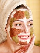 woman with clay facial mask. - stock photo