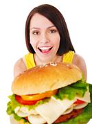 woman holding hamburger. - stock photo