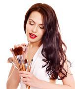 girl applying makeup. - stock photo