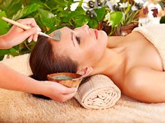 Stock Photo of clay facial mask in beauty spa.