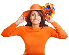 woman wearing orange sweater and hat. - stock photo