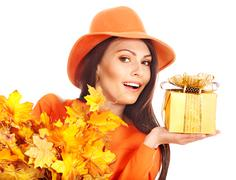 Stock Photo of woman holding autumn gift box .