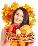 woman holding autumn basket. - stock photo