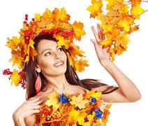 Stock Photo of girl with a wreath of autumn leaves on the head.