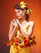 Stock Photo of girl with  autumn hairstyle and make up.