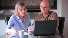 Middle Aged Caucasian Couple Paying Bills Online Banking With A Laptop Computer Stock Footage