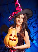 witch holding pumkin. - stock photo