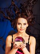 young woman  with crystal ball. - stock photo
