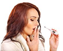 woman having  flue  taking thermometer. - stock photo