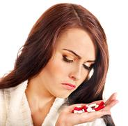 woman having pills and tablets. - stock photo