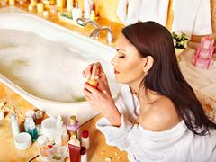 Woman applying moisturizer. Stock Photos