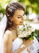 bride with flower outdoor. - stock photo