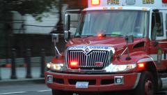 Ambulance DC (60P), close, in traffic, responding Stock Footage