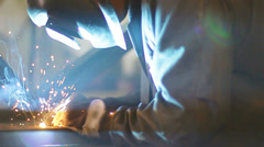 Worker working with welding in a workshop Stock Footage