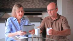 Mature Couple With A Tablet Computer Stock Footage