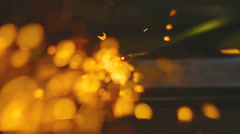 Sparks and flames from working with metal constructions - stock footage