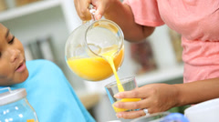 Young African American Mother Son Breakfast Juice Together - stock footage