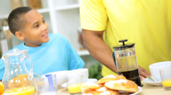 Ethnic Female Kitchen Wireless Technology Son Father Breakfast - stock footage