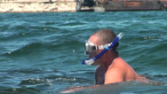 Stock Video Footage of diver in mask before diving into the water of the sea