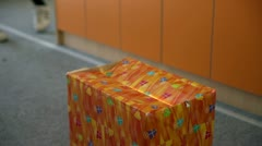 Orange box of surprise wrapped in decorative paper Stock Footage
