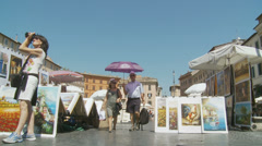 Selling art in Piazza Navona, Rome 1 (slomo dolly) Stock Footage