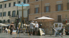 Selling art in Piazza Navona, Rome 3 (slomo dolly) Stock Footage