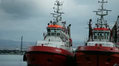 Two big towboats waiting in the harbor Stock Footage