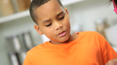 Young African American Boy Watching Mom Kitchen Close Up Stock Footage