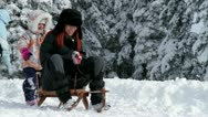 Mother and her daughter sleighing in winter time Stock Footage
