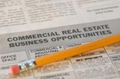 Close up of pencil and real estate newspaper ads - stock photo