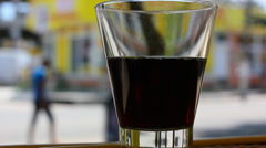 Glass of soda with city background Stock Footage