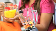 African American Family Blender Fresh Fruit Drink Stock Footage
