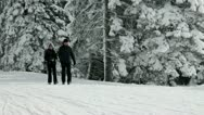 Couple walking on snowy road Stock Footage