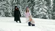 Mum, two girls enjoying on snow in winter Stock Footage