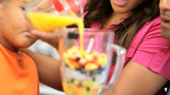 Close Up Young Ethnic Family Making Healthy Fruit Smoothie Stock Footage