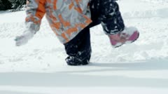 Little girl trudging through fresh snow in winter Stock Footage