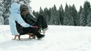 Family having fun with sleigh in winter Stock Footage