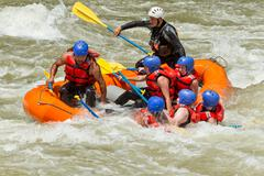 White Water Rafting Team In Bright Sunlight Pastaza River Ecuador Sangay - stock photo