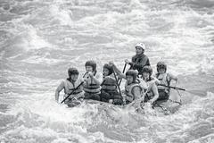 Stock Photo of A Group Of Men And Women With A Guide White Water Rafting On The Patate River
