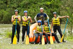 Stock Photo of Large Group Of Young People Ready To Go Rafting