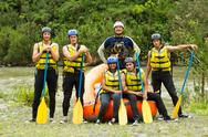 Stock Photo of whitewater rafting team
