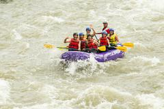 Whitewater Rafting Boat Group Of Seven People Stock Photos