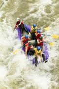 Stock Photo of Whitewater Rafting Boat Group Of Seven People