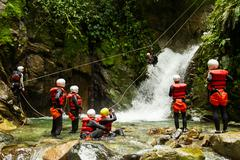Stock Photo of Group Of People Having Fun During A Canyoning Trip